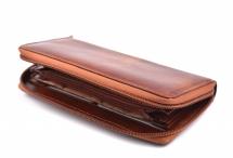 Dámská kožená peněženka na šířku s obvodovým zipem vybavená hnědá